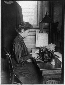 Woman typing c1906