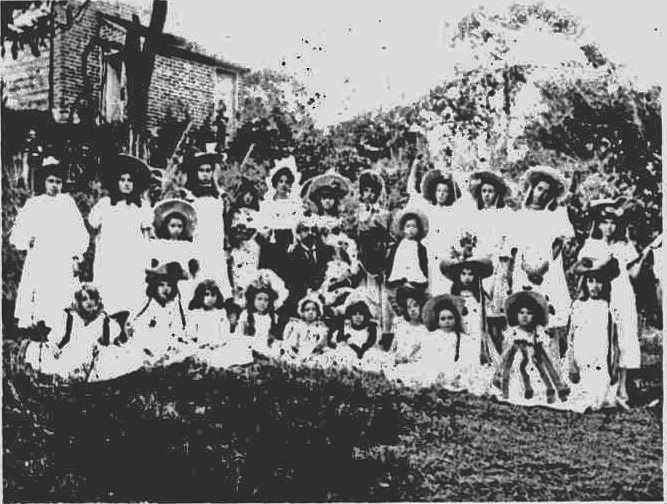 Newspaper photo of the cast of Red Riding Hood's Temptation