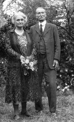 Edith and James Cowan in a garden in the 1920a