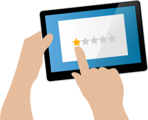 Cartoon image of hands holding tablet and hitting one star review